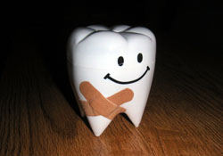 Thanks to Marie-Claire for the molar bank AND crisscross bandage idea.